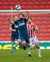 20th March 2021; Bet365 Stadium, Stoke, Staffordshire, England; English Football League Championship Football, Stoke City versus Derby County; Graeme Shinnie of Derby County controls the high ball