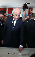 Tunisia's presidential candidate Kais Saied casts his ballot at a polling station in the capital Tunis on October 13, 2019 during the second round of the presidential election.