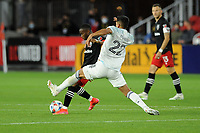 WASHINGTON, DC - MAY 13: Moses Nyeman #27 of D.C. United battles for the ball with Mauricio Pineda #22 of Chicago Fire FC during a game between Chicago Fire FC and D.C. United at Audi FIeld on May 13, 2021 in Washington, DC.