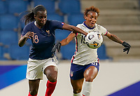 LE HAVRE, FRANCE - APRIL 13: Viviane Asseyi #18 of France and Crystal Dunn #19 of the United States battle for a ball during a game between France and USWNT at Stade Oceane on April 13, 2021 in Le Havre, France.