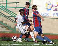 Alan Sanchez #18 and Neil Vranis #11 of Crystal Palace Baltimore lose the ball to Gregory Richardson #20 of the Carolina Railhawks during an NASL match at Paul Angelo Russo Stadium in Towson, Maryland on September 18 2010. Carolina won 4-2.