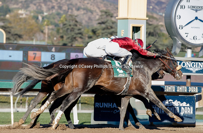 ARCADIA, CA JANUARY 30: #1 Medina Spirit, ridden by Abel Cedillo, holds off #4 Hot Rod Charlie, ridden by Joel Rosario, and #5 Roman Centurian, ridden Juan Hernandez, to win the Robert B. Lewis Stakes (Grade lll) on January 30, 2021 at Santa Anita Park in Arcadia, CA by Casey Phillips/EclipseSportswire/CSM)