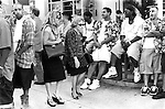 Two stressed looking business women push through a crowd of young men hanging out South Beach Ocean Drive,  Miami Florida USA  1999