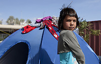 Pictured: A young girl at the makeshift camp  Monday 07 March 2016<br /> Re: Migrants have been gathering at the port of Piraeus, near Athens, Greece.