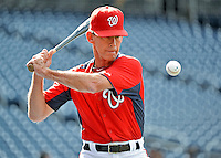 15 June 2012: Washington Nationals bullpen coach Jim Lett taps out grounders prior to a game against the New York Yankees at Nationals Park in Washington, DC. The Yankees defeated the Nationals 7-2 in the first game of their 3-game series. Mandatory Credit: Ed Wolfstein Photo