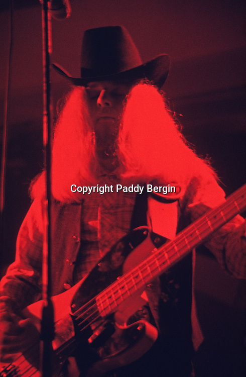 """Bassist Leon Wilkeson, Lynyrd Skynyrd, Dome Brighton 1974.<br /> <br /> Lynyrd Skynyrd is an American rock band best known for popularising the southern hard-rock genre during the 1970s.<br /> <br /> The band rose to worldwide recognition on the basis of its driving live performances and signature tunes """"Sweet Home Alabama"""" and """"Free Bird"""". At the peak of their success, three members died in an airplane crash in 1977, putting an abrupt end to the band's most popular incarnation.<br /> <br /> Stock Photo by Paddy Bergin"""