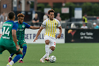 HARTFORD, CT - AUGUST 17: AJ Paterson #20 of Charleston Battery passes the ball as Alex Lara #2 of Hartford Athletic defends during a game between Charleston Battery and Hartford Athletic at Dillon Stadium on August 17, 2021 in Hartford, Connecticut.