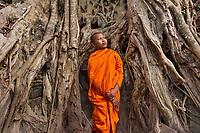 Monk at Banyan TRee, Angkor Wat, Cambodia 2006