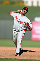 Scottsdale Scorpions pitcher Nefi Ogando (25) during an Arizona Fall League game against the Surprise Saguaros on October 11, 2014 at Surprise Stadium in Surprise, Arizona.  Scottsdale defeated Surprise 7-6.  (Mike Janes/Four Seam Images)