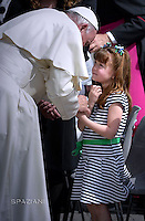 Pope Francis blesses five-year-old Lizzy Myers from the United States who suffers from a rare genetic disease which will take away her hearing and gradually make her blind General Papal audience, St. Peter's Square, Vatican City, Rome, Italy - 06 Apr 2016