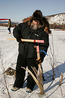 Wednesday March 7, 2007   ----  Race Manager, Mark Nordman, puts in a trail marker as he inspects the outgoing trail at the Ophir checkpoint.