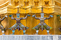 Bangkok, Thailand. Yakshas (Demons) Supporting the Gilded Chedi, Royal Grand Palace Compound.