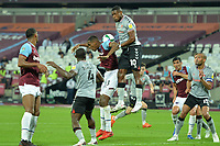 Chuks Aneke of Charlton Athletic FC jumps with Issa Diop of West Ham United during West Ham United vs Charlton Athletic, Caraboa Cup Football at The London Stadium on 15th September 2020