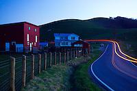FLOYD, VA,  A car's taillights illuminate the road near a farm in Pleasant Valley, Floyd, Virginia.