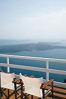 Terrace balcony overlooking a bay in Imerovigli, balcony to the Aegean, an area in Fira village, Santorini, Greece