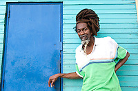 Montego Bay, Jamaica. Man with dreadlocks at local market. Jamaica Tourism.
