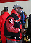 DION SANDERS watches the Prime Prep Academy Basketball team from Prime Prep Academy, the charter school Dion Sanders helped co-found, at the 2014 Metroplex Challenge at South Grand Prairie High School in Grand Prairie, Texas.