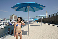August 2012   File Photo - Montreal, Quebec, CANADA -  Quai de l'horloge urban beach in Montreal's Old-Port...Model release for the main model in swimsuit only.