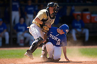 Matt Williams #18 of the Duke Blue Devils is tagged out at home plate by Michael Murray #15 of the Wake Forest Demon Deacons at Jack Coombs Field March 29, 2009 in Durham, North Carolina. (Photo by Brian Westerholt / Four Seam Images)