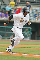 Charleston RiverDogs infielder Abiatal Avelino (19) at bat during a game against the Augusta GreenJackets at Joseph P.Riley Jr. Ballpark on April 15, 2015 in Charleston, South Carolina. Charleston defeated Augusta 8-0. (Robert Gurganus/Four Seam Images)