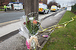 """© Joel Goodman - 07973 332324 . 27/12/2011 . Salford , UK . Flowers left at the scene reading """" Sorry we could not have done more . I was so sure you would pull through """". Police forensic scenes of crime examiners work at the scene of the murder of Anuj Bidve on Ordsall Lane . Bidve was shot and killed by Kiaran Stapleton on 26 December 2011 . Photo credit: Joel Goodman"""