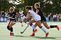 Olivia Shannon competes with Tyler Lench (L) and Liz Thompson during the Women's North v South hockey match, St Pauls Collegiate, Hamilton, New Zealand. Saturday 17 April 2021 Photo: Simon Watts/www.bwmedia.co.nz