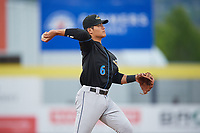 Akron RubberDucks shortstop Yu-Cheng Chang (6) warmup throw to first base during a game against the Binghamton Rumble Ponies on May 12, 2017 at NYSEG Stadium in Binghamton, New York.  Akron defeated Binghamton 5-1.  (Mike Janes/Four Seam Images)