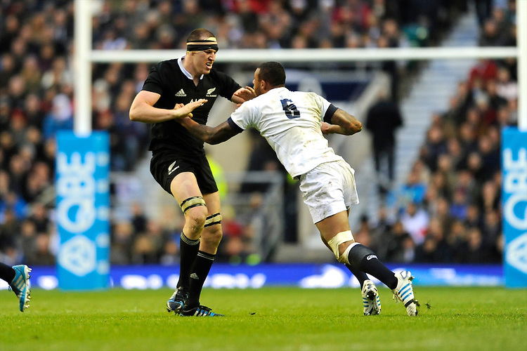 Brodie Retallick of New Zealand and Courtney Lawes of England clash during the QBE Autumn International match between England and New Zealand at Twickenham on Saturday 16th November 2013 (Photo by Rob Munro)