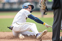 Michigan Wolverines shortstop Jack Blomgren (2) slides into third base during Game 11 of the NCAA College World Series against the Texas Tech Red Raiders on June 21, 2019 at TD Ameritrade Park in Omaha, Nebraska. Michigan defeated Texas Tech 15-3 and is headed to the CWS Finals. (Andrew Woolley/Four Seam Images)