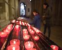 Lisbon, UK. 04.05.2015. People light candles within the Se de Lisboa (Lisbon Cathedral). Photograph © Jane Hobson, UK.