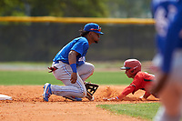 Toronto Blue Jays Otto Lopez (11) attempts to field a throw as Leroux Brando (11) steals second base during an exhibition game against the Canada Junior National Team on March 8, 2020 at Baseball City in St. Petersburg, Florida.  (Mike Janes/Four Seam Images)<br /> <br /> 11 slides in