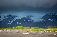Ominous dark storm clouds over the Aleutian mountain range along the coast of Katmai National Park, Alaska Peninsula, southwest Alaska.
