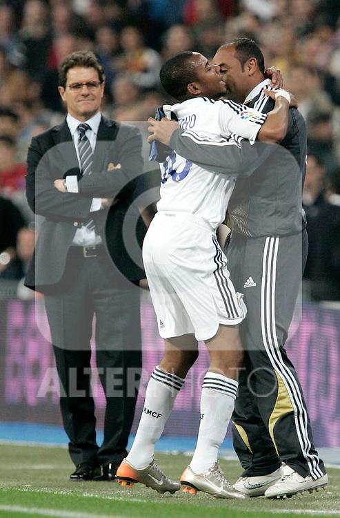 Real Madrid's Robinho celebrates with teammate Emerson after scoring close to coach Fabio Capello during Spain's La Liga match at Santiago Bernabeu stadium in Madrid, Sunday March 18, 2007. (ALTERPHOTOS/Alvaro Hernandez).