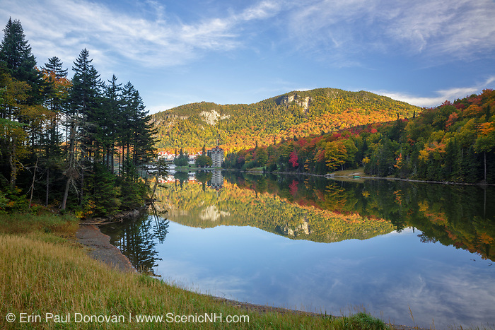 Dixville Notch - Lake Gloriette in Dixville, New Hampshire USA during the autumn months. The Balsams Grand Resort is in view