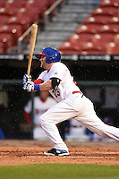 Buffalo Bisons designated hitter Brett Carroll (23) base hit during a game against the Gwinnett Braves on May 13, 2014 at Coca-Cola Field in Buffalo, New  York.  Gwinnett defeated Buffalo 3-2.  (Mike Janes/Four Seam Images)