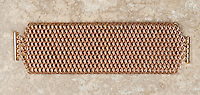 """A brass and bronze dragonscale weave chainmail bracelet.  The maille was made with 18ga 1/4"""" bronze and 19ga 11/64"""" jeweler's brass, and uses a gold tone slide clasp."""