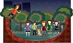 Teenagers skateboarding in a park