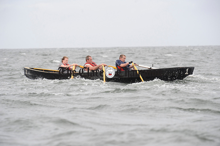 Tom Blunnie, Sino Madigan and Sean Honan of Kilrush in action at the Leon Currach Regatta at Seafield, Quilty. Photograph by John Kelly.