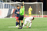 FOXBOROUGH, MA - OCTOBER 09: Referee Kenneth Rojas gives a yellow card to Nicolas Firmino #29 of New England Revolution II after a collision with Eduardo Sosa #10 of Fort Lauderdale CF during a game between Fort Lauderdale CF and New England Revolution II at Gillette Stadium on October 09, 2020 in Foxborough, Massachusetts.