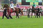 .Arc de Triomphe in Paris.  Presentation before the race. Workforce (GB) wins the race. Jockey Ryan. L. Moore Owner : K Abdullah. Trainer : M.R. STOUTE