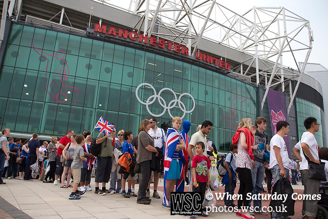 Uruguay 2 United Arab Emirates 1, Great Britain 1 Senegal 1, 26/07/2012. Old Trafford, Olympic Games. Spectators queueing for security checks outside Manchester United's Old Trafford stadium prior to the Men's Olympic Football tournament matches at the venue. The double header of matches resulted in Uruguay defeating the United Arab Emirates by 2-1 while Great Britain and Senegal drew 1-1. Over 72,000 spectators attended the two Group A matches. Photo by Colin McPherson.