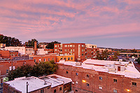 An aerial view of the downtown mall cityscape at sunset with colorful skies in Charlottesville, VA. Photo/Andrew Shurtleff
