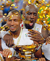 "France`s basketball team players Boris Diaw and Johan Petro celebrate with the trophy after European championship ""Eurobasket 2013""  final game between France and Lithuania in Stozice Arena in Ljubljana, Slovenia, on September 22. 2013. (credit: Pedja Milosavljevic  / thepedja@gmail.com / +381641260959)"