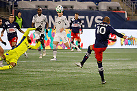 20th November 2020; Foxborough, MA, USA;  New England Revolution midfielder Teal Bunbury has Montreal Impact goalkeeper Clement Diop off his line but shoots over the bar during the MLS Cup Play-In game between the New England Revolution and the Montreal Impact