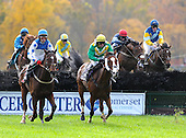 Early in the Grand National, History Boy, left, and Jack Cool stalk Divine Fortune as Royal Bonsai, red cap, and Pierrot Luanire (far right) give chase.