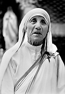 """Calcutta, India. April 04, 1975. Mother Teresa in front of a statue of the Virgin Mary at her Kalighat Home for the Dying in Calcutta. The first Home for the Dying opened in 1952 and was a free hospice for the poor. Mother Teresa (Agnes Gonxha Boyaxihu) the Roman Catholic, Albanian nun revered as India's """"Saint of the Slums,"""" was awarded the 1979 Nobel Peace Prize."""