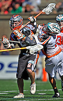 23 August 2008: Denver Outlaws' Midfielder Brian Langtry (6) is checdked by Los Angeles Riptide Midfielder Jimmy Borell (2) during the Semi-Finals of the Major League Lacrosse Championship Weekend at Harvard Stadium in Boston, MA. The Outlaws edged out the Riptide 13-12, advancing to the upcoming Championship Game.. .Mandatory Photo Credit: Ed Wolfstein Photo