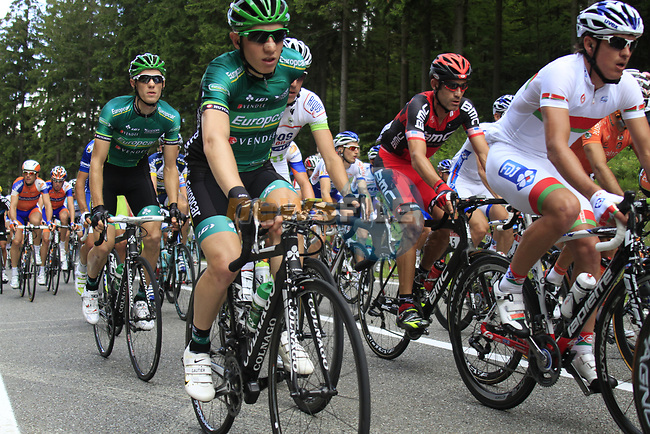 The peloton including George Hincapie (USA) BMC Racing Team and Pierre Rolland (FRA) Europcar Team climbs the Cote de Francorchamps during Stage 1 of the 99th edition of the Tour de France, running 198km from Liege to Seraing, Belgium. 1st July 2012.<br /> (Photo by Eoin Clarke/NEWSFILE)
