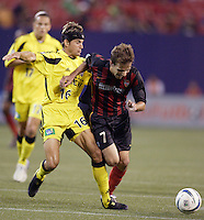 The Crew's Ross Paule trips up the MetroStars' Mike Magee.  The MetroStars and the Columbus Crew played to a 1-1 tie at Giant's Stadium, East Rutherford, NJ on Sunday August 29, 2004.