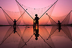 Fishermen working at sunset by Aung Ya